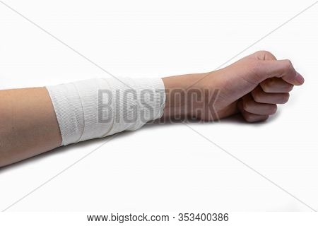 Wide Bandage With A Sterile Gauze On An Arm Of A Boy On White