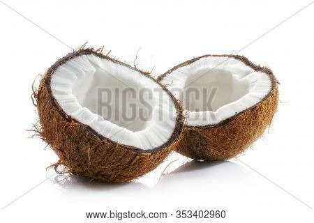 Coconut Opened. Halved Ripe Coconut Closeup