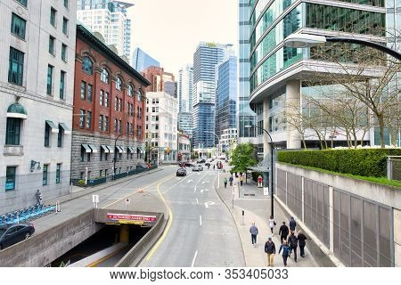 Vancouver - May 06 2019: Downtown Vancouver, Canada. A View From Above Across The Street With Walkin