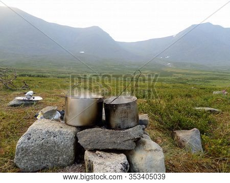 Cooking On A Halt At A Campfire In Pots. Mountain Landscape. Natural Landscape. Photowall-paper. Sub