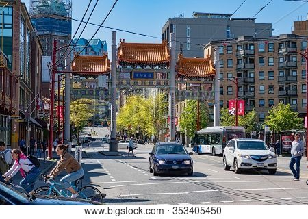 Vancouver, Canada - May 05 2019:downtown Vancouver, Canada. Millennium Gate On Pender Street In Chin