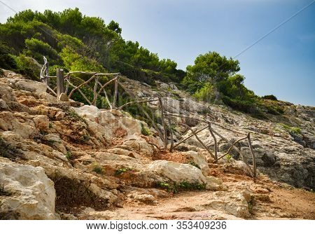 Traditional Wooden Fence On Hiking Path On Sea Coast In Atalis Nature Park Near Sant Tomas In Menorc