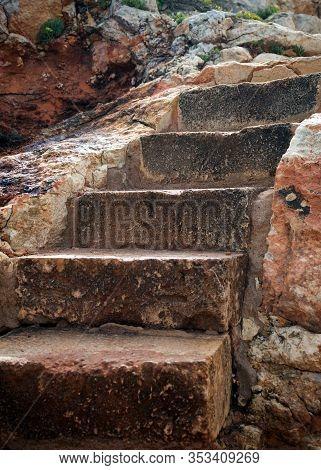 Old Stone Steps On Hiking Path On Sea Coast In Atalis Nature Park Near Sant Tomas In Menorca Island