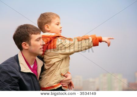 Father With Son Who Points Finger To Right
