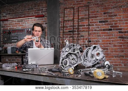 Man Work With Caliper Measure The Motor Gear, Study On The Computer And Search In Internet Spare Eng