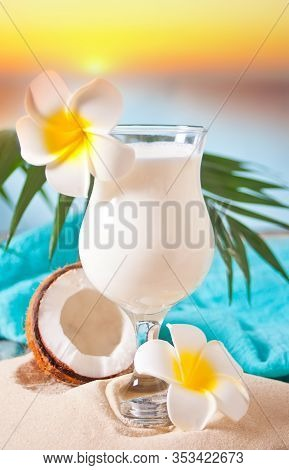 Traditional Caribbean Exotic Tropical Cocktail Drink Pina Colada In A Glasses With Plumeria Frangipa