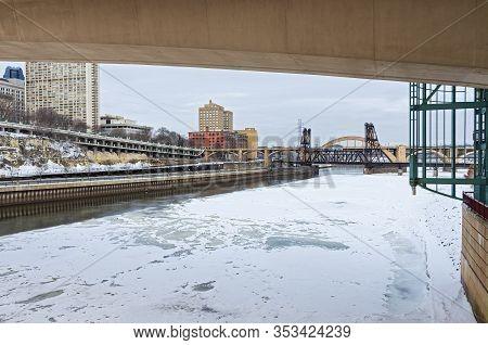 Downtown Saint Paul And Landmark Robert Street Bridge And Vertical Lift Bridge Spanning Frozen Missi