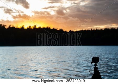 Shooting On The Action Camera Of A Natural Phenomenon (time Lapse). Sunset / Sunrise Behind The Fore