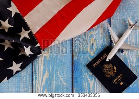Travel Tourism, Emigration The Usa American National Flag With U.s. Passport And Passenger Model Pla