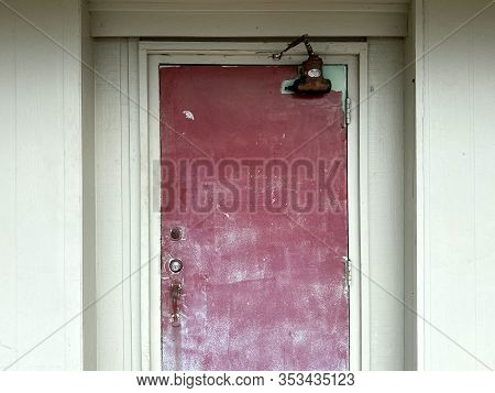 Detailed Old Rusted Locked Red Warehouse Back Door