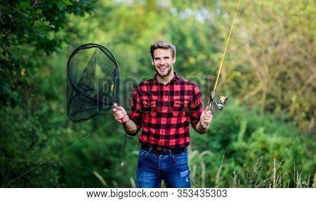Fishing Day. Handsome Guy In Checkered Shirt With Fishing Equipment Nature Background. Fishing In My