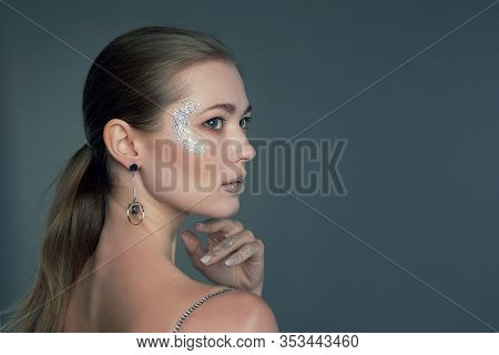 Fashion Make-up. Shiny Oil Skin, Beautiful Young Woman With Clean Perfect Skin. Close Up, Copyspace