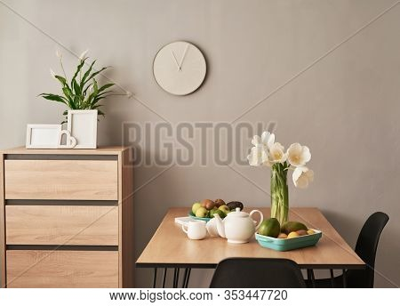 Beautiful Tea Service On Wooden Table. Home Interior Decor, Bouquet Of Flowers In Vase, Table With S