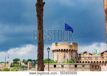 View Of Castel Sant Angelo, Saint Giovanni Bastion, Eu Flag . Cloudy Summer Day