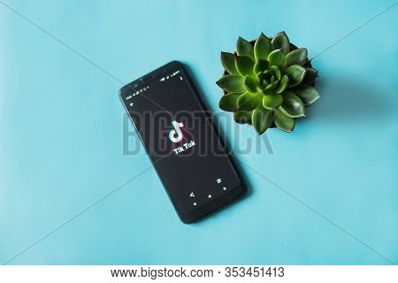 Tver, Russia - February 28, 2020 Succulent And Tik Tok Logo On Smartphone Screen On Blue Background.