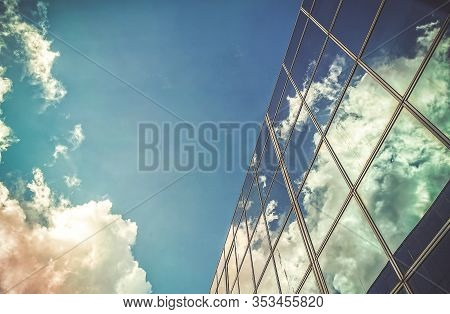 Amazing Cloud And Sky Reflection On Window Glass Building.