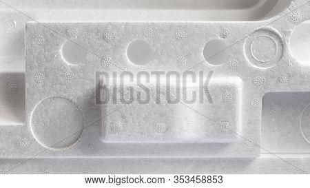 Polystyrene Or Styrofoam Padding For Product Packaging. Detail Of Styrene Foam Plastic Box Close-up.