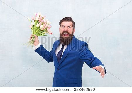 Hate Holidays. Womens Day. March 8. Angry Bearded Man With Flowers. Celebrate Spring. Date Failure.