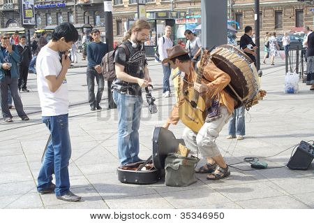 People Listening To The Performance Of A Peruvian Street Musician On August 05, 2012 In St. Petersbu