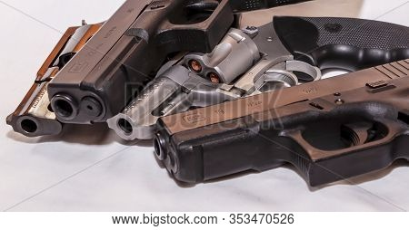 Pittsburgh, Pennsylvania, Usa 2/29/20 Four Handguns, Two Glocks, 9mm And 40 Caliber And Two Revolver