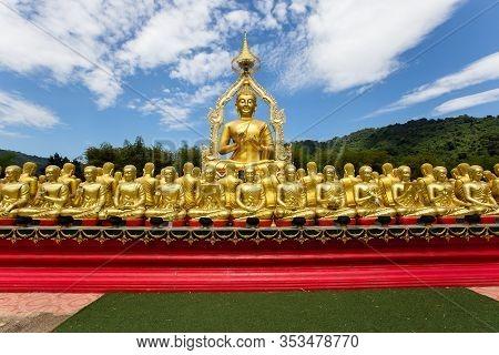 Row Of Golden Buddha In Thailand. Golden Buddha Statues At Temple Of The Emerald Buddha, Wat Phra Ka