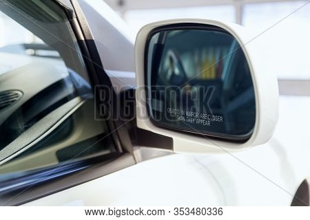 Side Rear-view Mirror With An Inscription Warning That Objects Are Closer Than Cadets