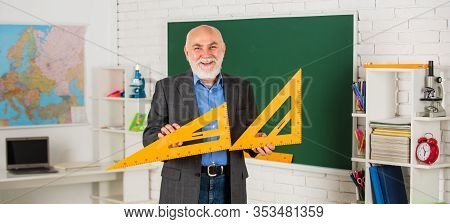Solve Mathematical Problems. Mature Man Teacher Use Math Triangle Tool. Bearded Tutor Man At Blackbo