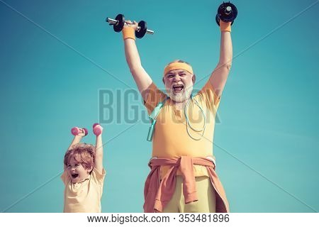 We Exercise Every Day. Like Sports. Sport Exercise For Kids. Old Mature Man And Little Boy Exercisin