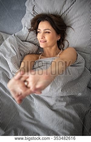 Pretty, young woman in her bed, fast asleep. Importance of sleep concept