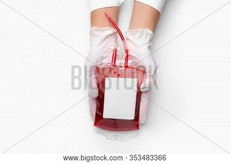Hands Of Doctor With Blood Pack For Transfusion On White Background