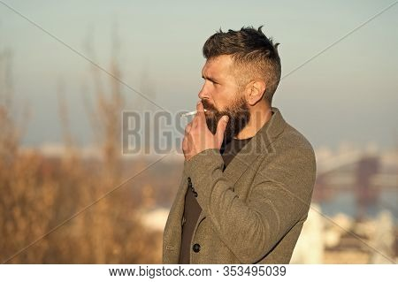 Cigarette Tobacco Harmful Health Influence. Smoking Aesthetics. Smoking Devices Concept. Bearded Hip