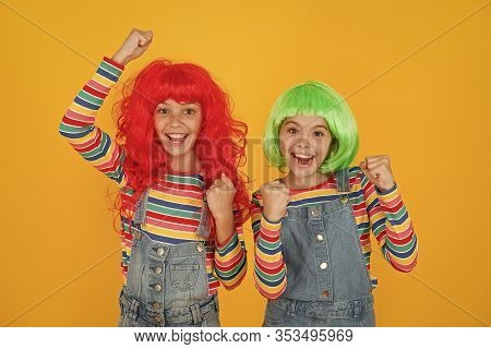 Being Happy. Happy Children Make Victory Gestures Yellow Background. Little Girls Celebrate Victory