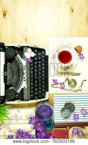 Vintage Writers Desk Creative Composition Flat Lay With Typewriter And Books.