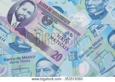 A Close Up Image Of A Purple, Twenty Metical Bank Note From Mozambique On A Background Of Mexican Tw