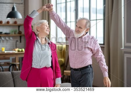 Happy Elderly Couple Dancing And Enjoying Their Day