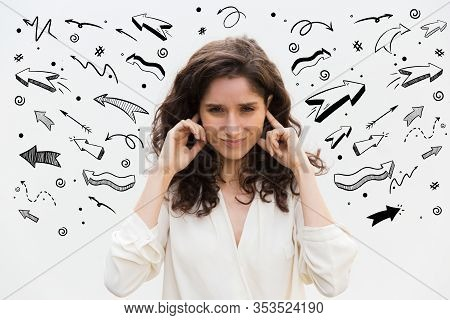 Front View Of Irritated Young Woman Plugged Ears With Fingers. Angry Lady With Closed Eyes Posing In