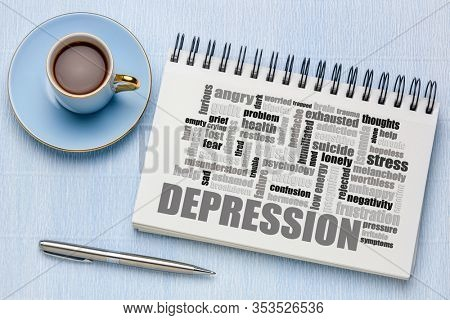 depression word cloud in a sketchbook with a cup of coffee, wellbeing and mental health concept