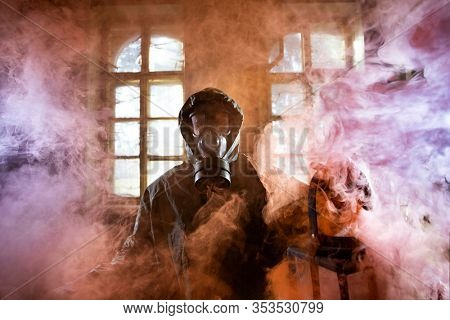 Post apocalyptic survivor in gas mask in the smoke. Environmental disaster, armageddon concept.