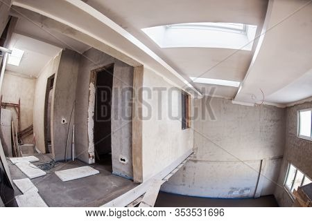 interior of construction site with drywall completely installed at new two level apartment  work in progress to the new house