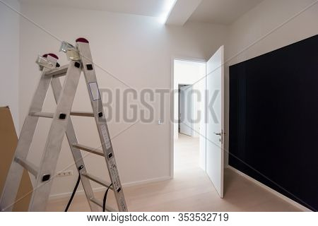 ladder in Interior of apartment during construction, remodeling, renovation, extension, restoration and reconstruction