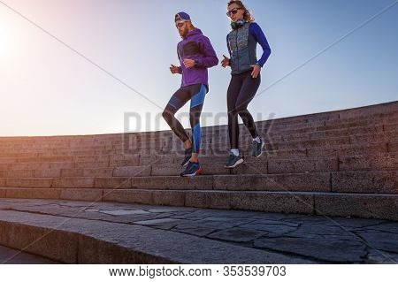 Sporty Couple Running Down On The Stairs