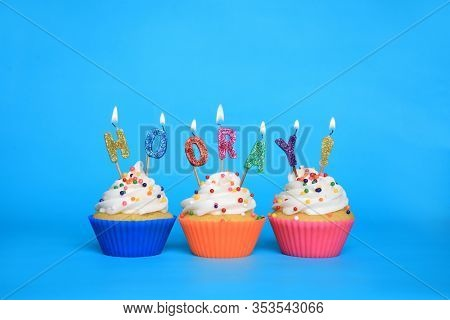 Happy Birthday Cupcakes With Candles That Say Hooray