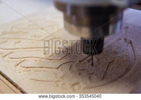 wood milling on modern automatic woodworking machine with CNC. furniture production.