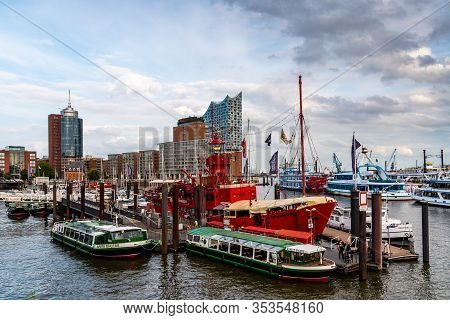 Hamburg, Germany - August 4, 2019: View Of The Port Of Hamburg And Elbphilharmonie During The Sunset