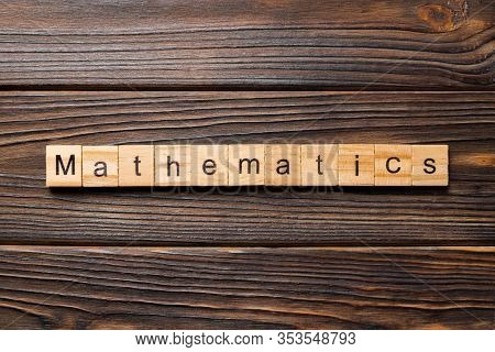 Mathematic Word Written On Wood Block. Mathematic Text On Wooden Table For Your Desing, Concept