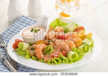 Grilled Shrimp Salad With Fresh Lettuce, Cherry Tomatoes And Creamy Sauce. Large Portion On A White