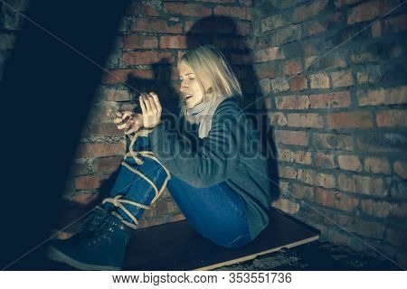 Blonde With Her Hands And Feet Tied Is Sitting In The Basement Screaming And Calling For Help. Conce