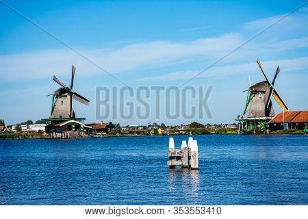 Zaanse Schans, Netherlands - 1 October 2019: Traditional Dutch Windmills In Zaanse Schans, A Typical