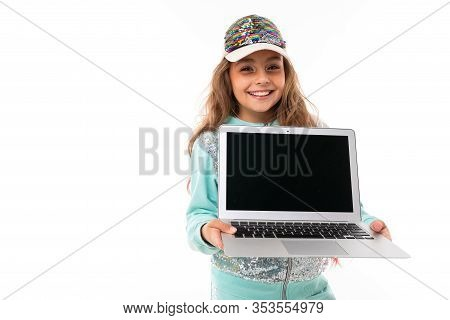 Little Beautiful Caucasian Girl With Long Wavy Chestnut Hair And Nice Smile In Traksuit And A Cap Sm