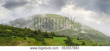 Mountain Peak Hoverla In The Carpathian Mountains Partly In Clouds In Summer. View Of Southwest Slop